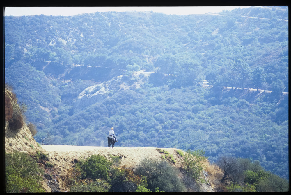 Griffith Park Rider (From the slide installation Real Estate) 2013 Fine art archival print from 35mm slide, 15 x 21.5 in