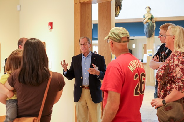 Preston Cook leads a tour of his collection in the exhibition  Eagles Over the Water,  during Second Saturday: Eagles Extravaganza.