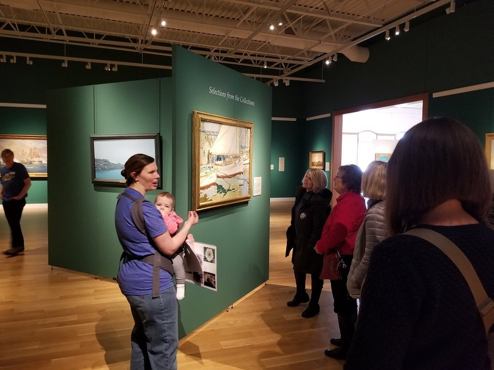 Volunteer Docent Jenn Beachle (with Magnolia in tow), leads a tour during Second Saturday: Women in Art.