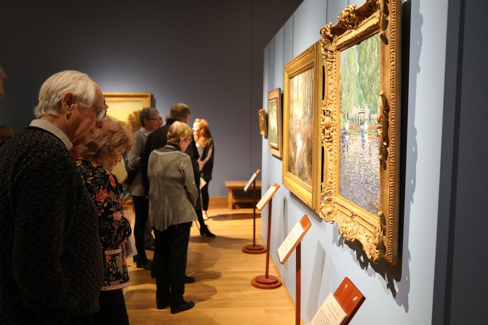 Attendees get a sneak peek at newly unveiled works at the April 14, 2019 fundraiser unveiling.