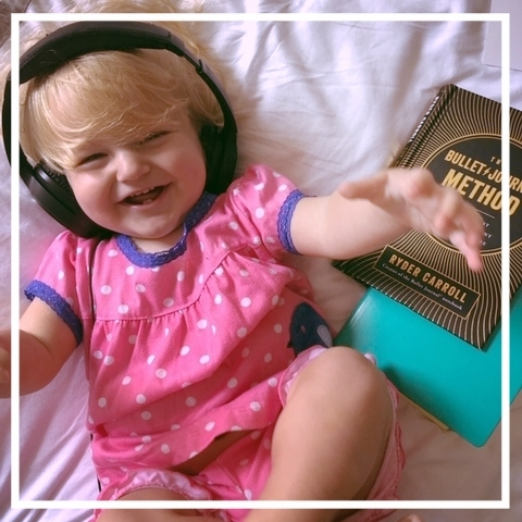 I've started a Bullet Journal page for capturing baby Eliza's milestones. She LOVES wearing my podcast headphones.