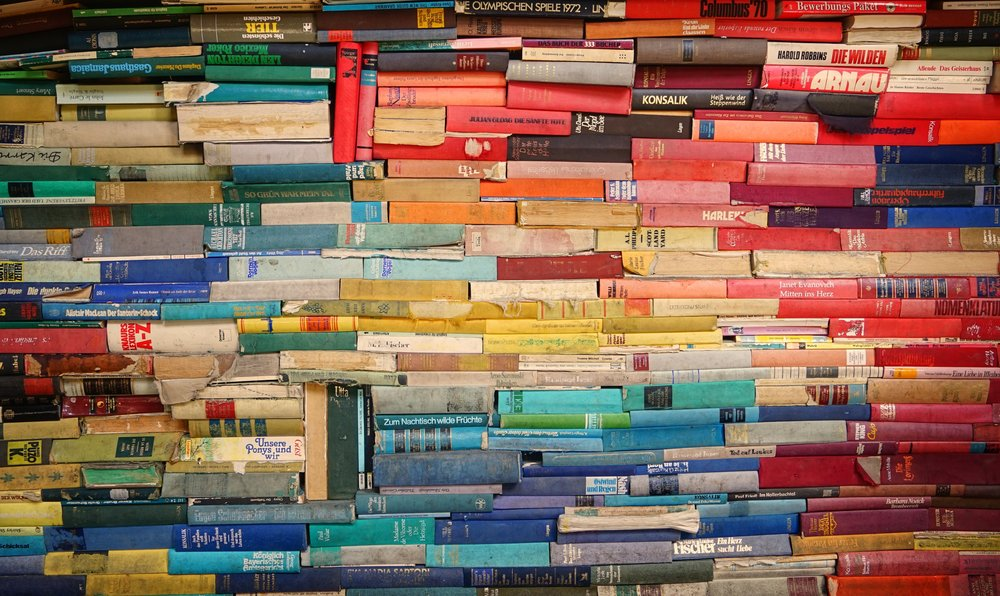 piles of books atomic moms podcast