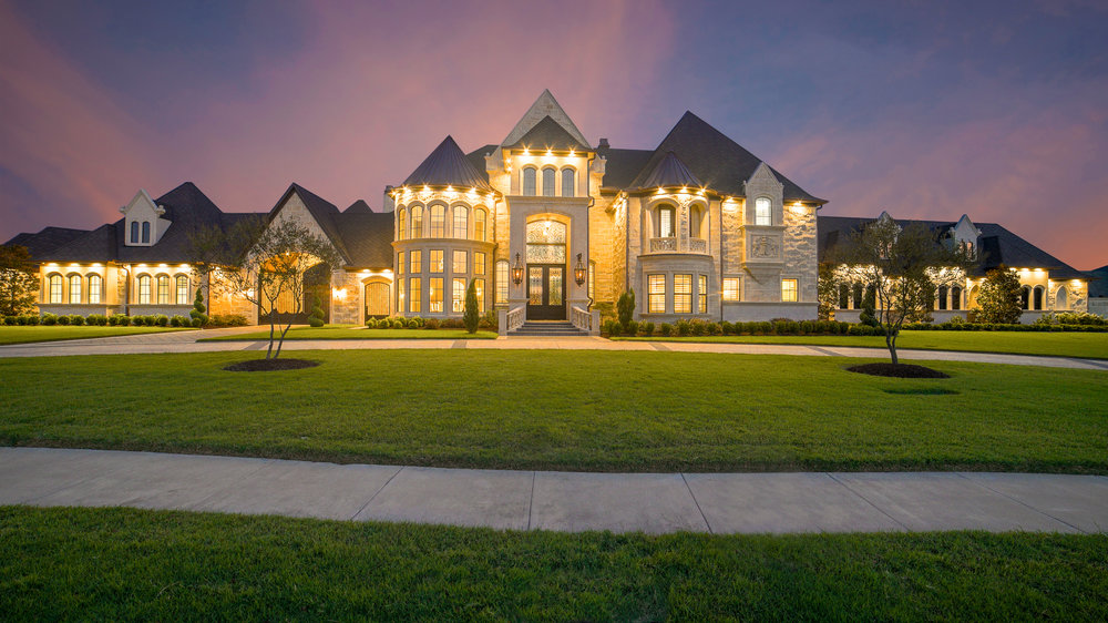 Large house at dusk that you would need to be prequalified for.