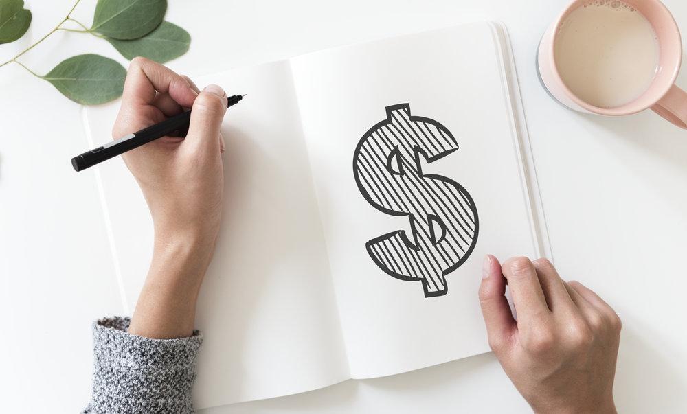 Girl drawing a dollar sign.