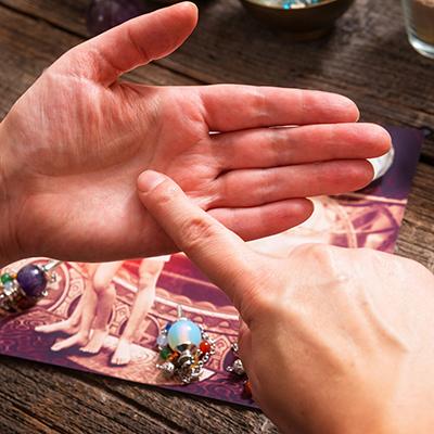 palm-reading-66937668.jpg