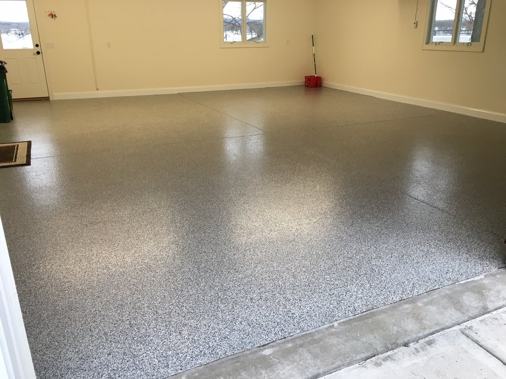 Flake floor systems are a multiple layer heavy duty application utilizing a decorative flake oftentimes in multiple combinations to give a beautiful high wear surface to any garage, shop, basement or anywhere that a high wear surface is needed.