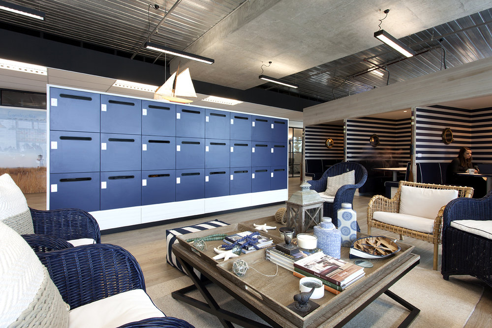 Blue lockers with white custom surround by Lockin