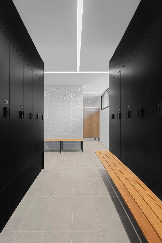Black laminate lockers with bench seat by Lockin