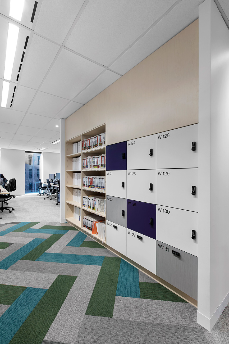 Integrated timber laminate office lockers and bookshelf at Willis Towers Watson