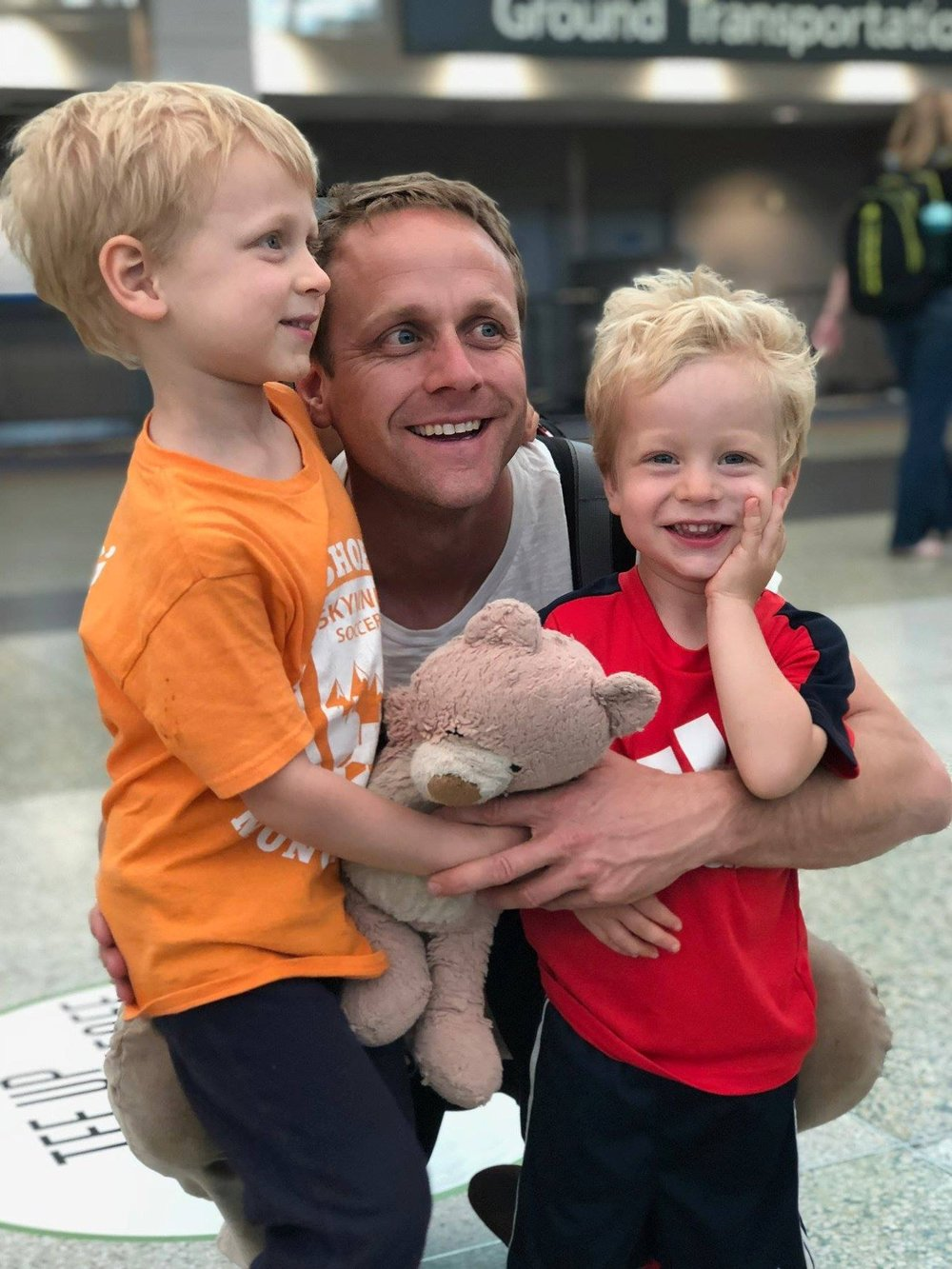 Toren and his sons Henry & George at DIA after Toren returned from reserve duty overseas