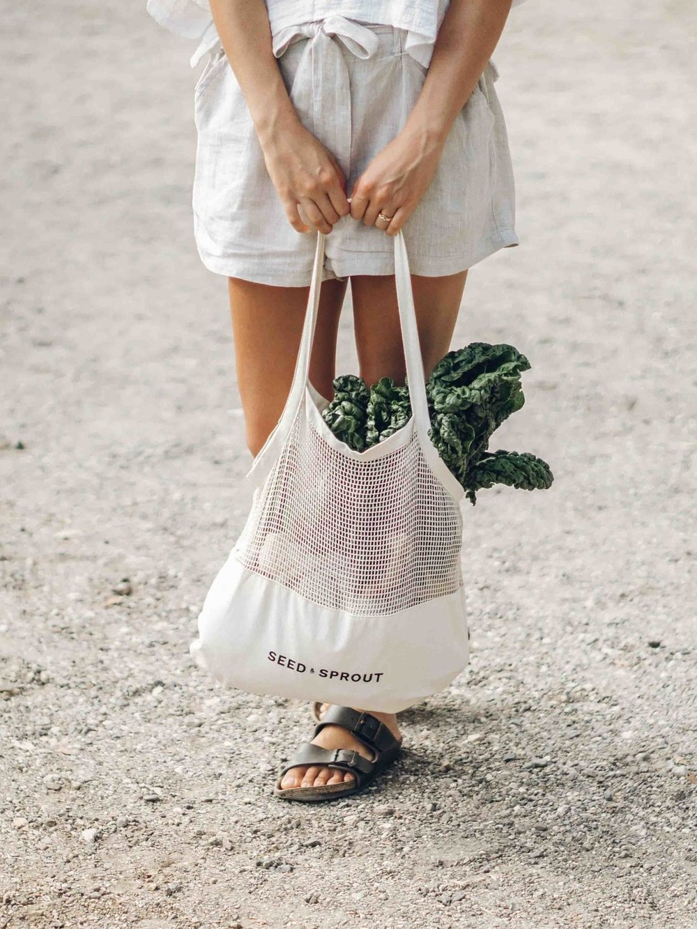 Keira-Mason-Seed-and-sprout-walking-with-white-bag.jpg