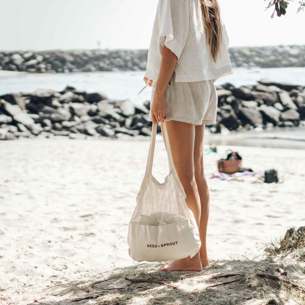 Keira-Mason-Seed-and-sprout-holding-bag-at-beach.jpg