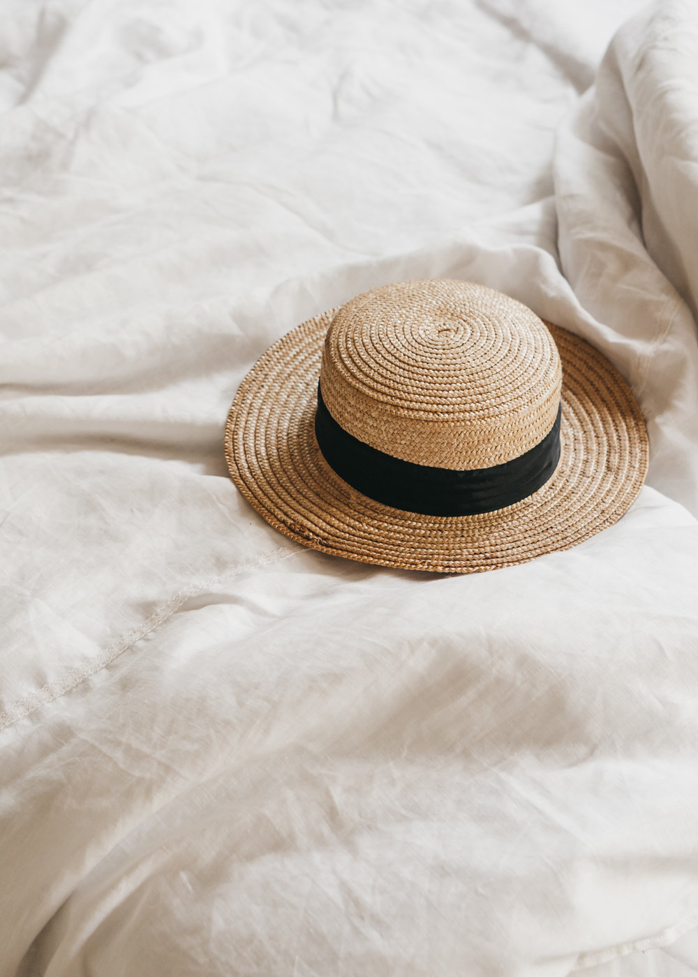 Keira-Mason-in-between-the-sheets-straw-hat-bed.jpg