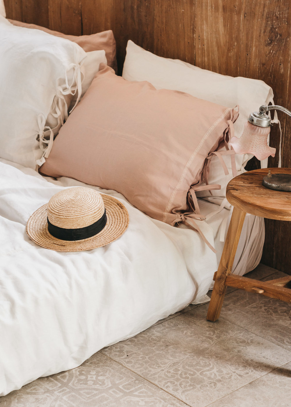 Keira-Mason-in-between-the-sheets-straw-hat-in-bed.jpg
