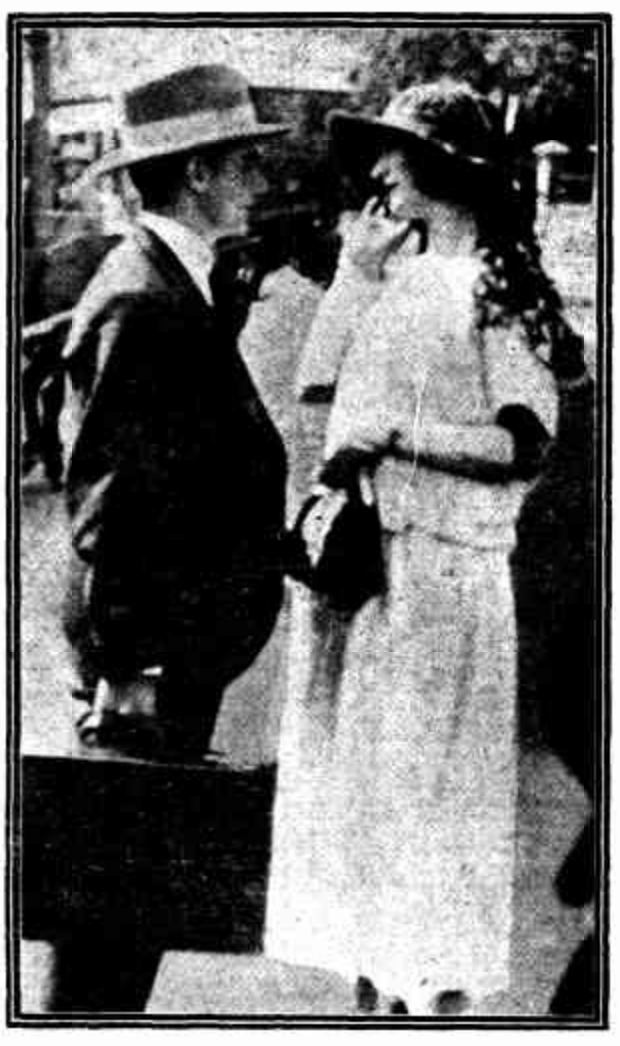 Miss Helen Josephine Sadler, Auburn's girlfriend and Crown witness, in conversation with a clerk from the defense team. The Sunday Times, 4 May 1924.