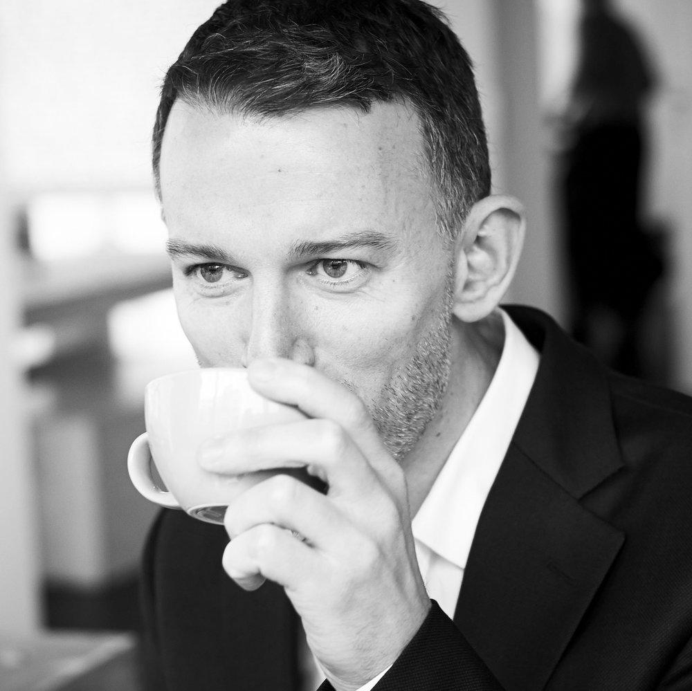 David Collins drinking coffee