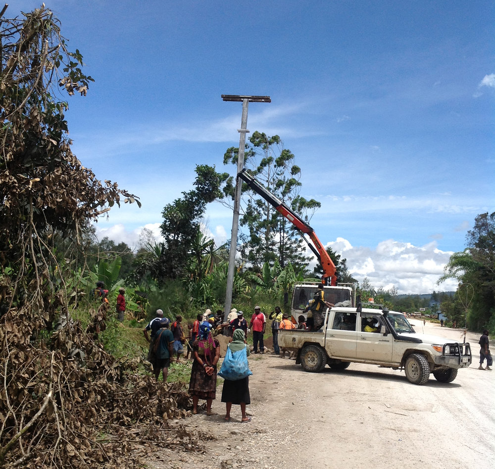 PNG Power Limited installing electricity poles in the Highlands.