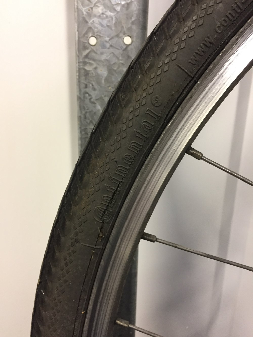This tyre is cracked at the logo. Under high tyre pressure and passenger load the sidewall could split further, causing a catastrophic failure during a ride. This tyre should be replaced as a safety precaution.