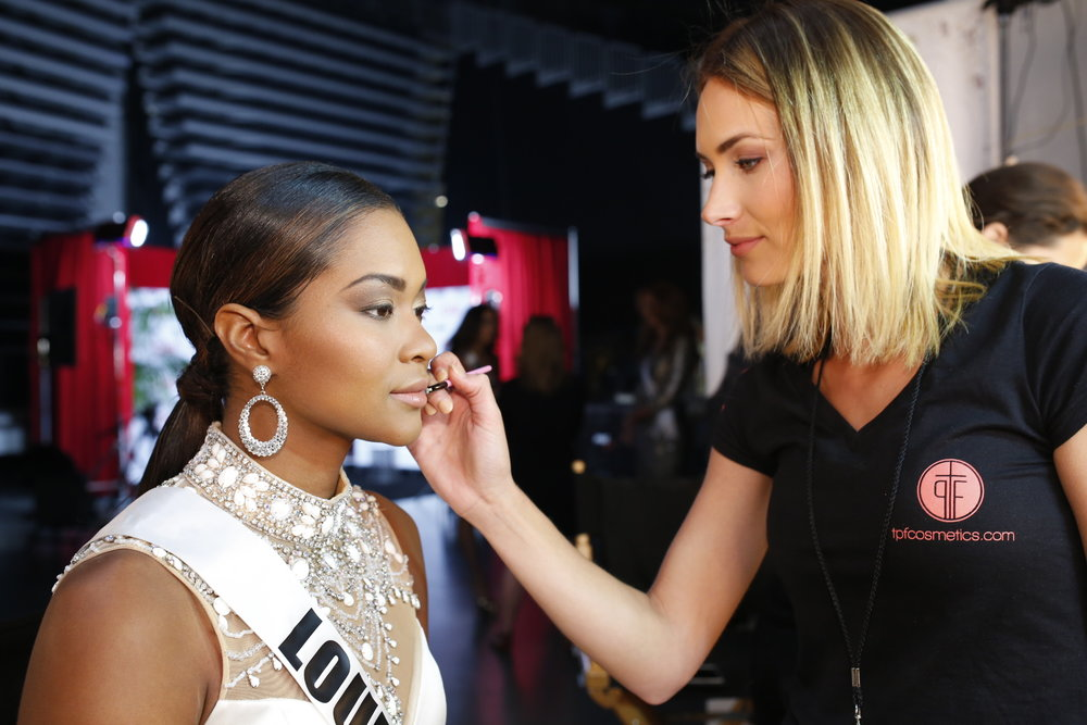 Brittany Guidry working as a backstage makeup artist at Miss USA.