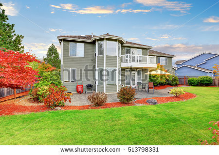 stock-photo-well-kept-backyard-garden-and-patio-area-of-american-two-story-house-northwest-usa-513798331.jpg