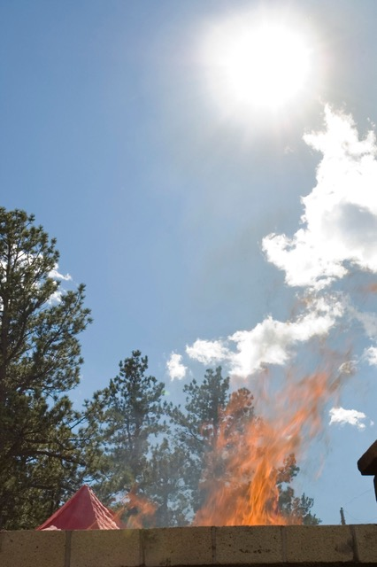 Open air cremation fire at the private pyre at Shambhala Mountain Center. Photo by Corey Kohn
