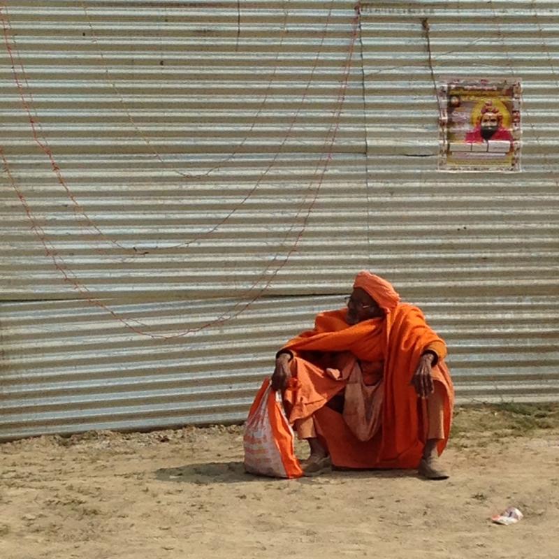 a sadhu at Kumbha Mela, passing the time