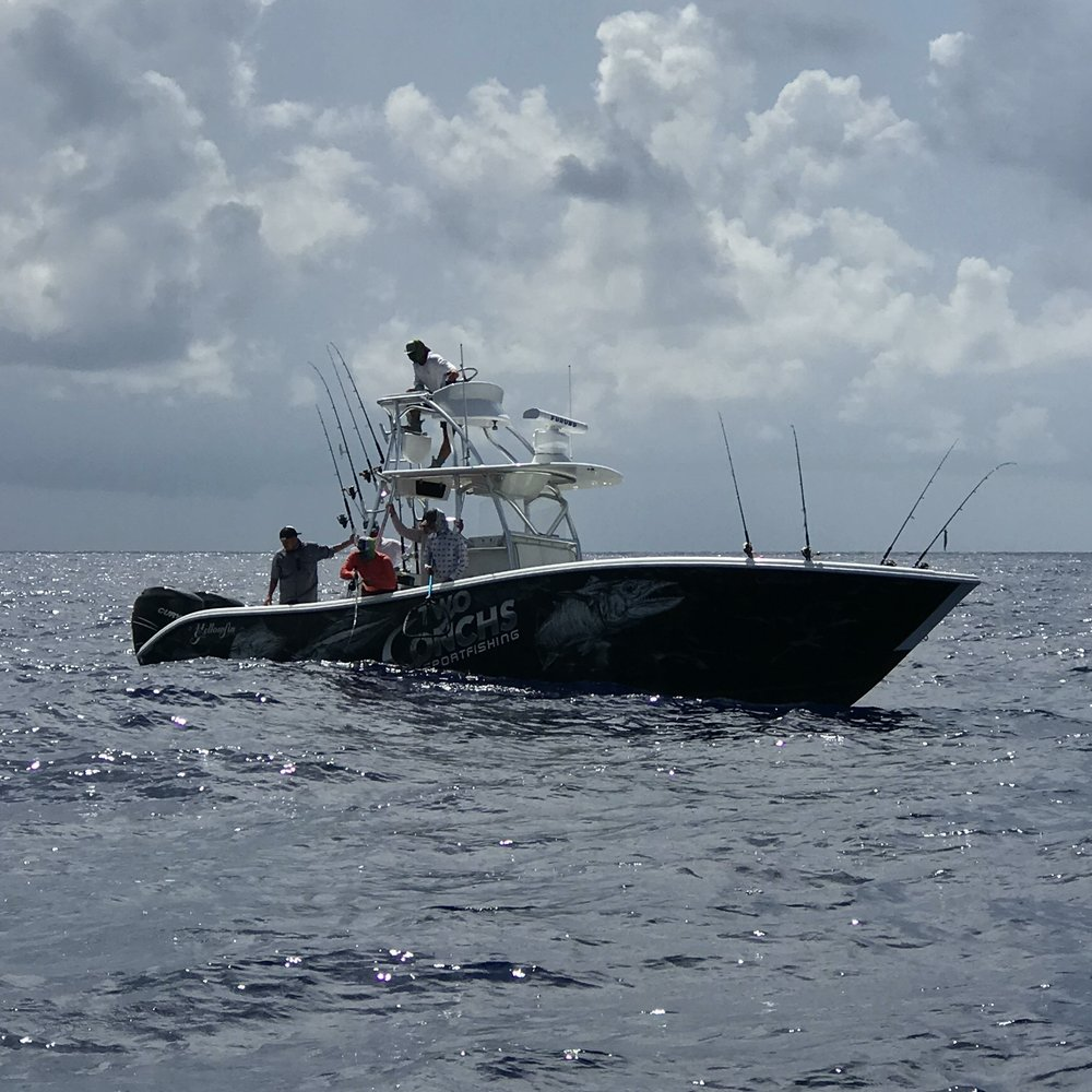 Captain Brandon hooked up to a tuna near us at the humps