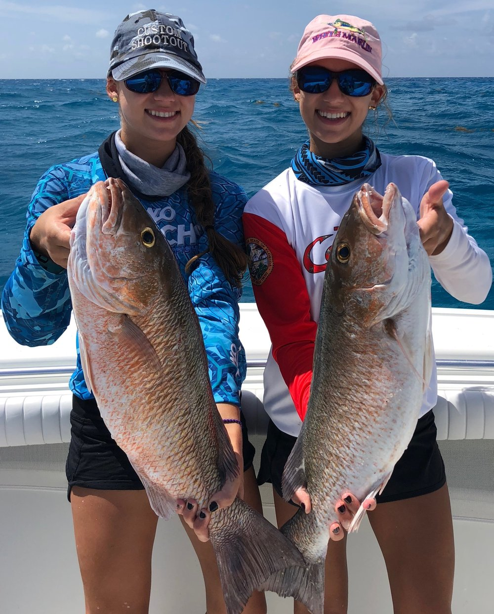 Captain Emily (left) and I with our mangrove snapper!