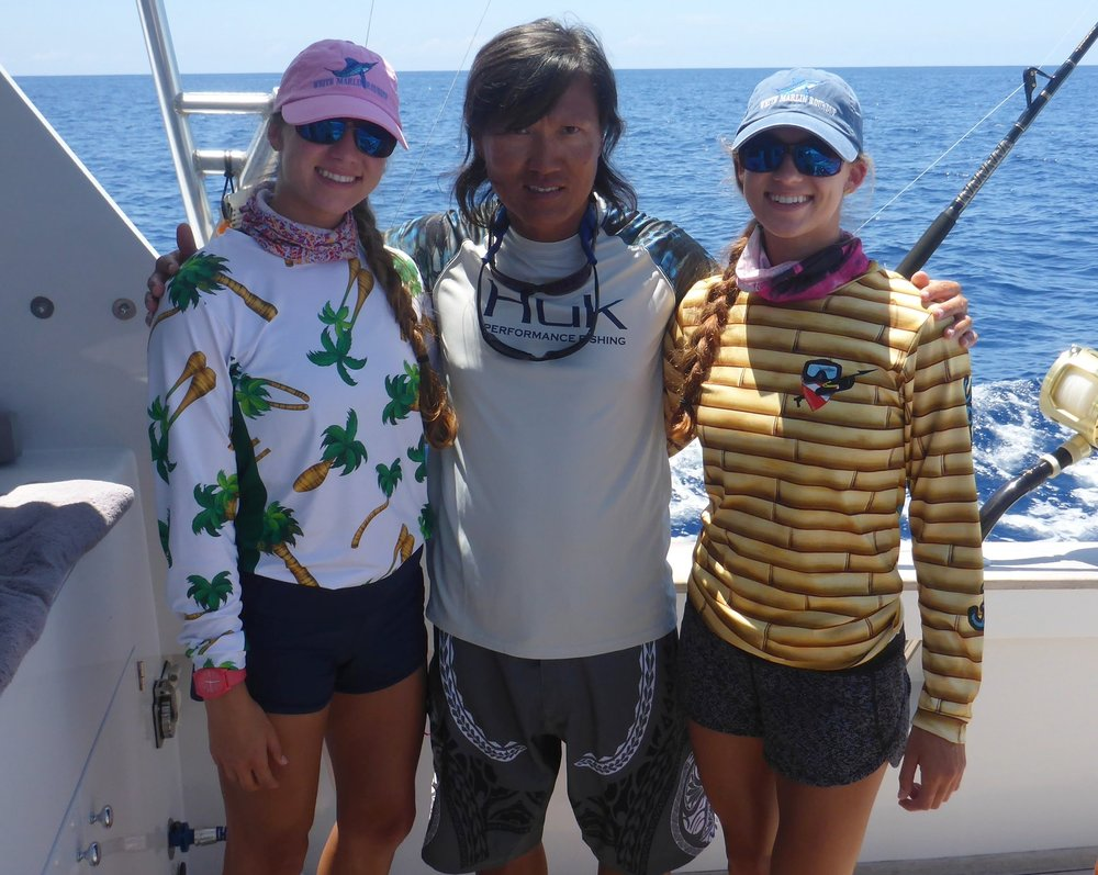 Emily (left), Captain Mike Tan & Amanda (right)