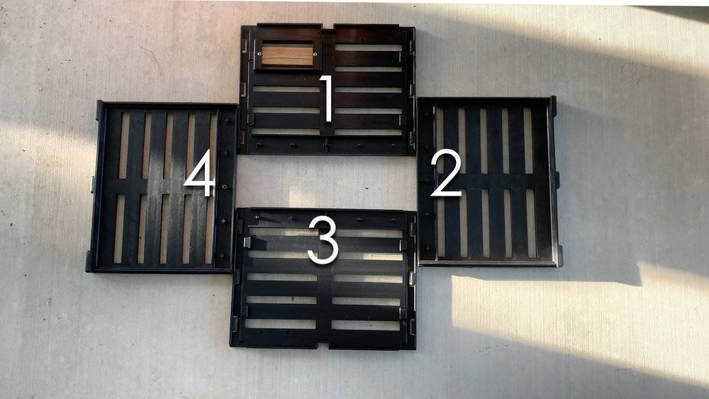 1. Side with wooden chew out window  2, Side with square tops facing out/up  3. Side with no square tops  4. Side with square tops facing out/up