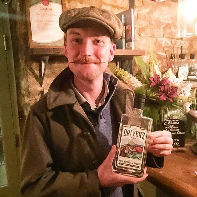 """What-ho!"" We just bumped into The Driver's Tipple character Miles' doppelgänger! This fine fellow is in fact a purveyor fine vintage collectibles @thetimetravellers94 and we doff our driving cap to that! . . Our driving character Miles was created for us by the excellent @bryn_parry_studios . . . #thedriverstipple #designateddriver #vintageclothing #retro #drivinghero #ginlovers #nonalcoholic #brynparry #classicars #gentlemandriver"