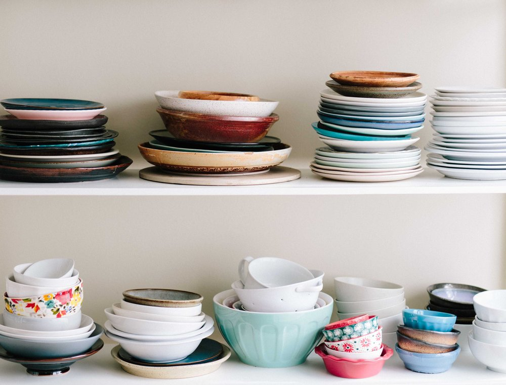 Stacks of dishes in cabinet