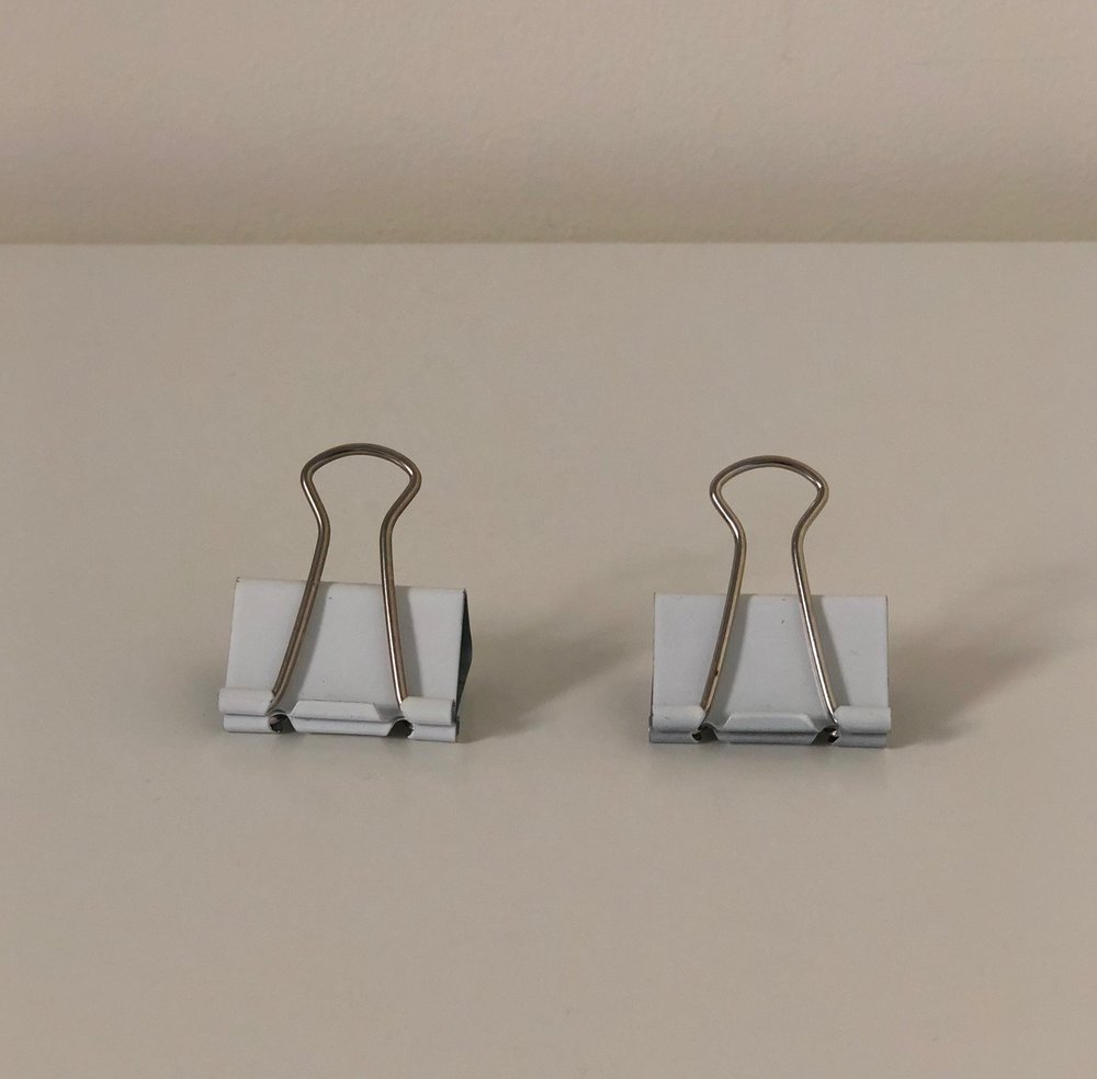 8. Binder Clips - Useful For: Affixing prints to the wall, creating a notebook from scrap paper, guiding cords.
