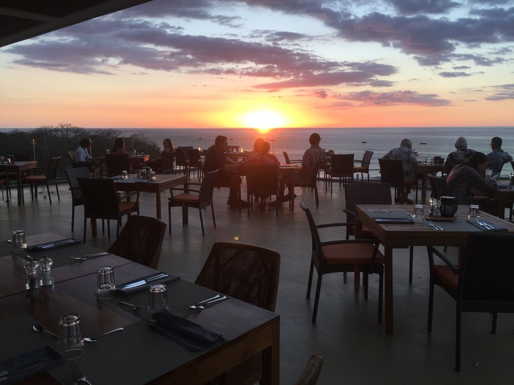 Dinner at the Hotel Lagarta Lodge in Nosara, with the most romantic sunset you can imagine. Off to our right is the estuary where we would be kayaking the next day.