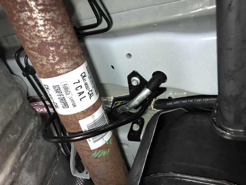 Fuel line passing over the exhaust