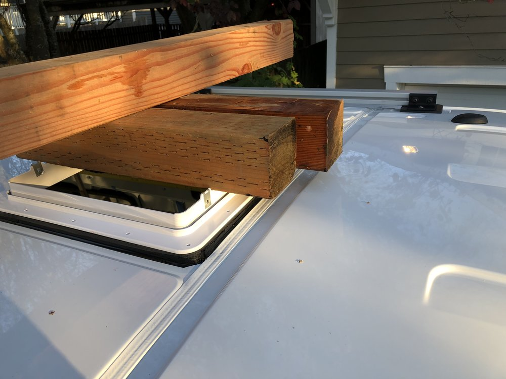 Applying light pressure while gluing down vent
