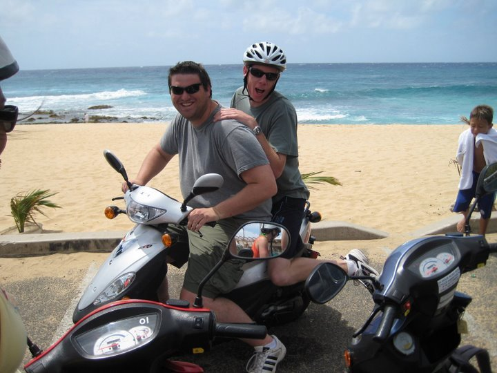 Greg and Eric on their sweet bike at Sandy Beach