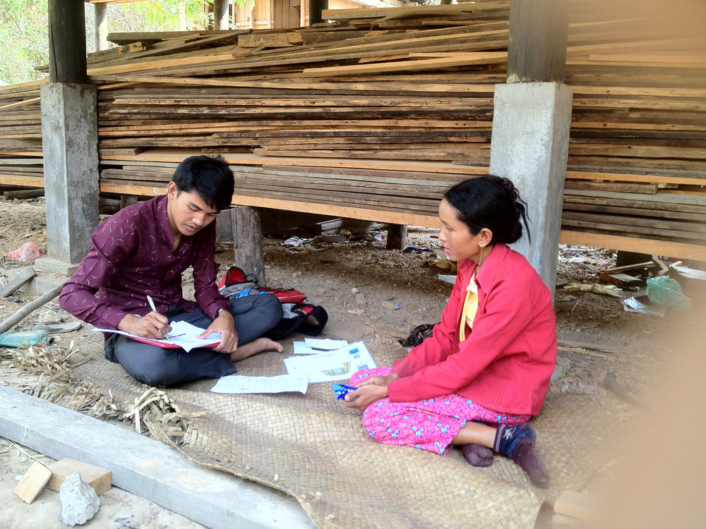 A community member in Cambodia shares her preferences as part of IDinsight data collection.