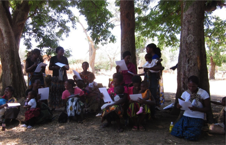 Mothers complete their surveys as part of data collection exercises.