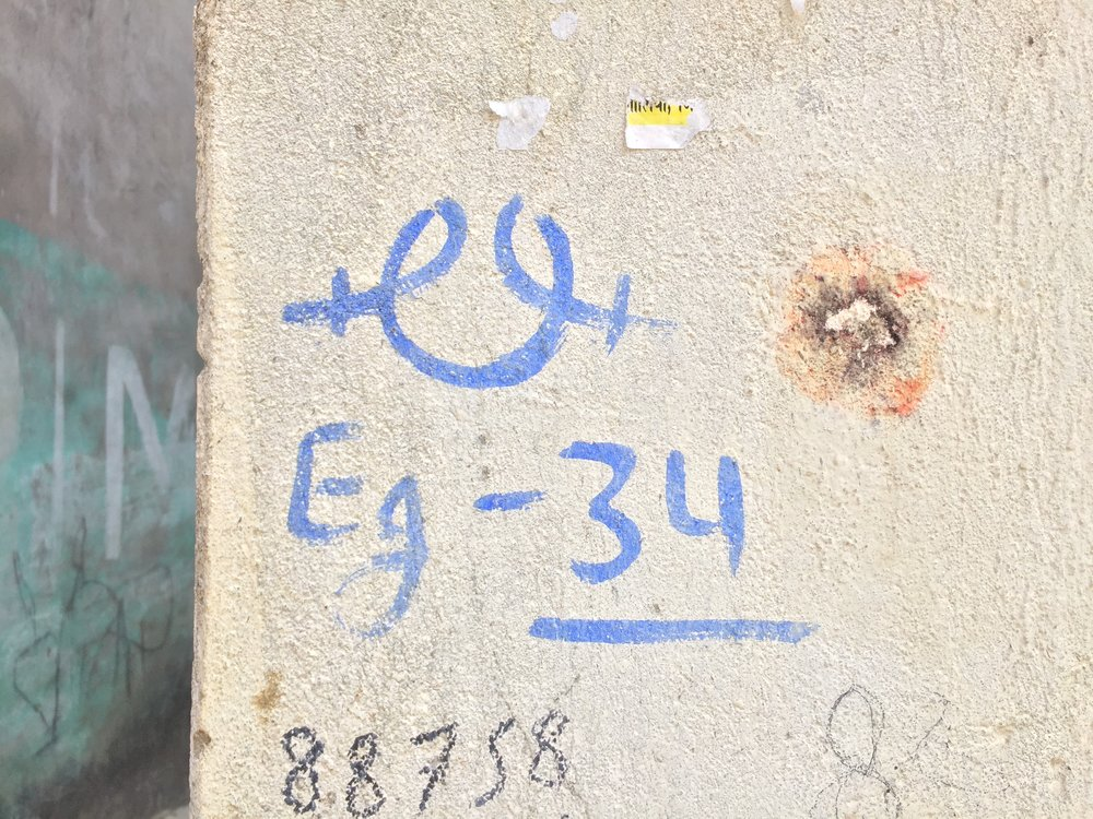 The Educate Girls symbol painted on a village home to indicate the households surveyed.