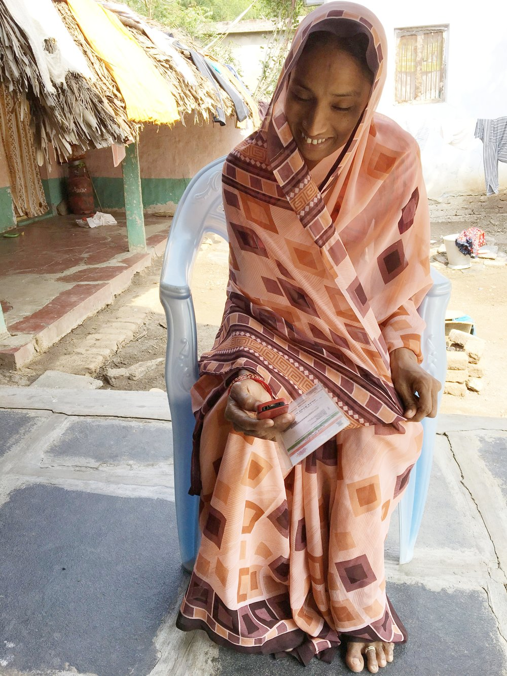 A woman responds to survey questions during questionnaire piloting in Krishna District, Andhra Pradesh.