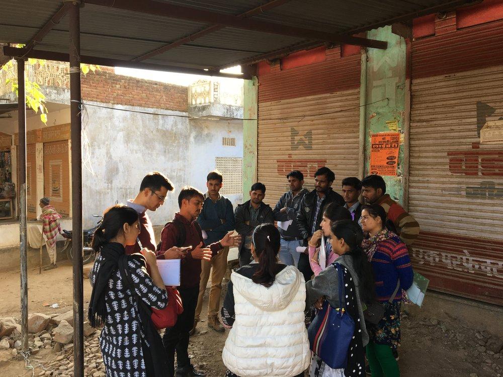 IDIRI %2F%2F IDIRI team members lead a debrief meeting while piloting the survey tool in Jaipur District, Rajasthan (Dec 2017) %2F%2F Photo_ Elizabeth Bennett.JPG