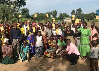 Business groups show off their cash disbursements after a Village Enterprise event.