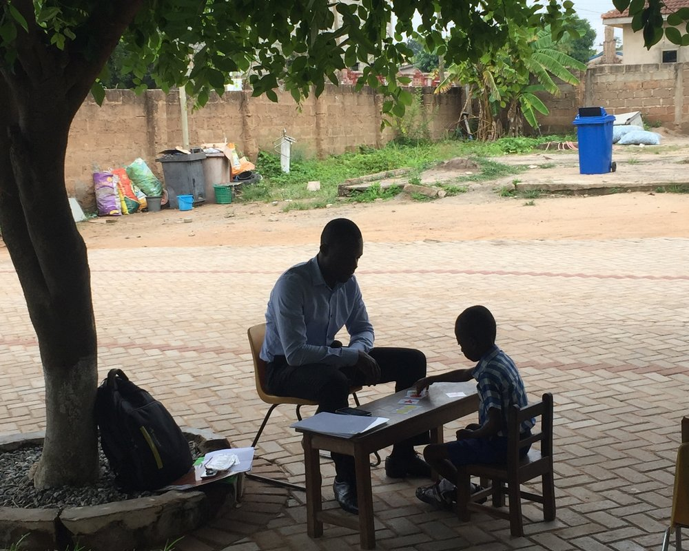 Enumerator (Maxwell) assesses student using IDELA at Bright School Complex, Accra, Ghana.