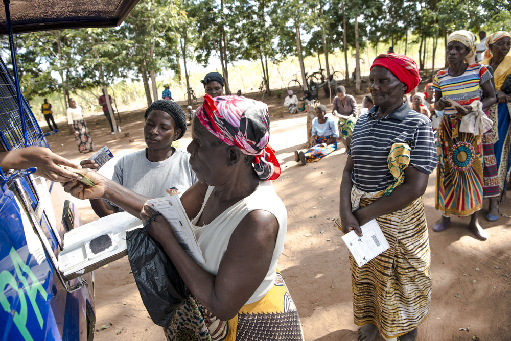 Women receive their cash transfers. Photo Credit: Malawi Ministry of Gender, Children, Disability and Social Welfare