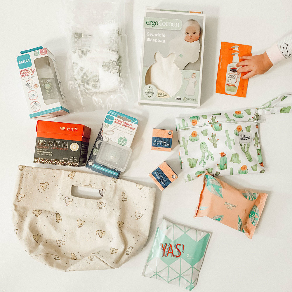 VIP Baby & Postpartum Gift Basket (Over $115 value) - This gift basket is full of my favorite baby & postpartum items: Full size bottles of Motherlove nipple cream, ergoPouch swaddle sleep bag, MAM pacifiers & bottle, Parasol Co. diaper and wipe samples, a box of Mrs. Patel's lactation tea, Oh La Lari Reusable nursing pads, Palmer's stretch cream sample, Pehr Designs canvas storage tote. This basket will have you prepared for your first weeks at home with your new baby. Happy mail is coming your way!