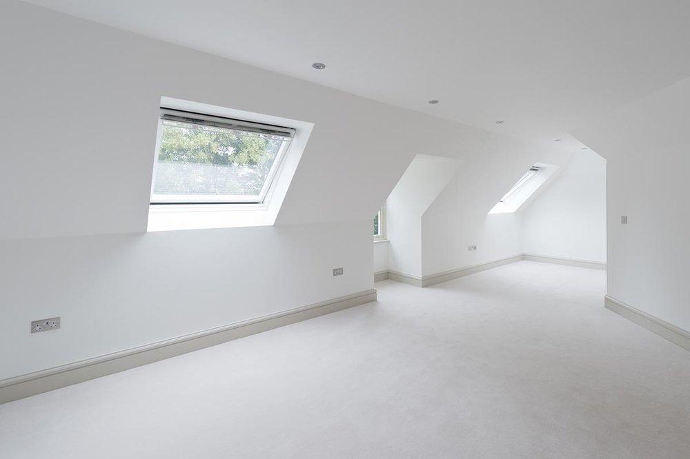 Deepdale bedroom with slanted ceilings