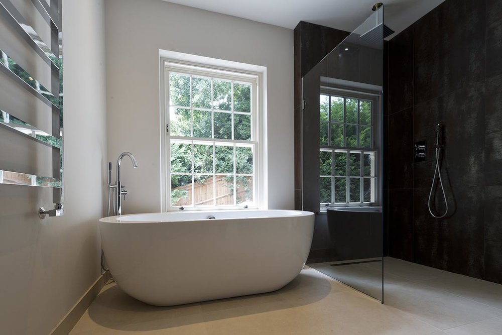 Deepdale bathroom with bath and shower