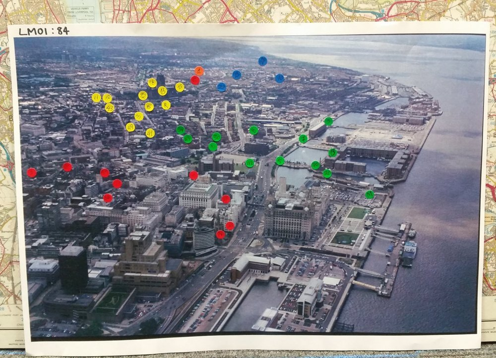 Aerial photograph of Liverpool city center with coloured stickers which mark points of historical/archaeological interest.