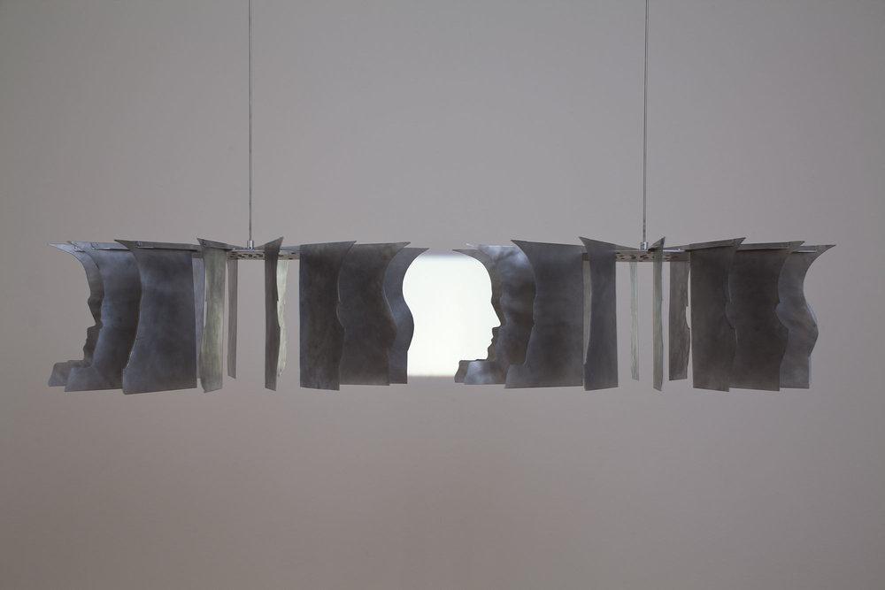 Markus Raetz   Kopflose Mühle (Mulino acefalo),  1993-2002 Alluminio 32 elementi, 26 cm ognuno Acquisto 2007   ESPANDI
